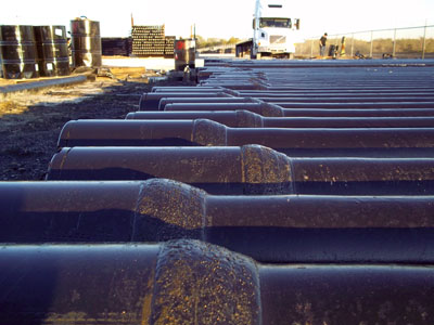Hard banding (shown here) can extend the life of drill pipe when used on rock crossings. Consult with your vendor about the placement and types of hard banding that are available.