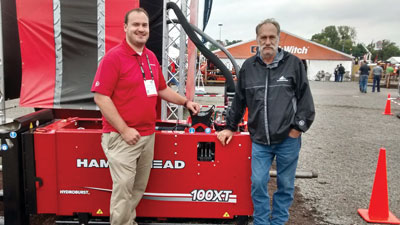 HammerHead's Adam Czuprynski (left) and Kelvin Aus display the 100XT Pipe Bursting Machine.