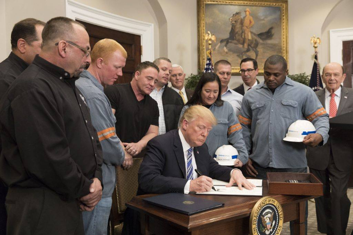 President Donald J. Trump signs the Section 232 Proclamations on Steel and Aluminum Imports (Official White House Photo by Joyce N. Boghosian)